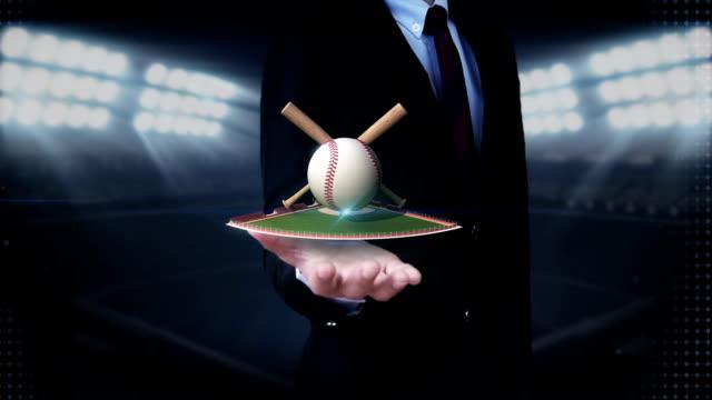 Businessman open palm, baseball, bat, ball.field. video