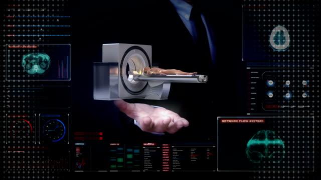 Businessman open palms, CT scanner in digital display dashboard. video