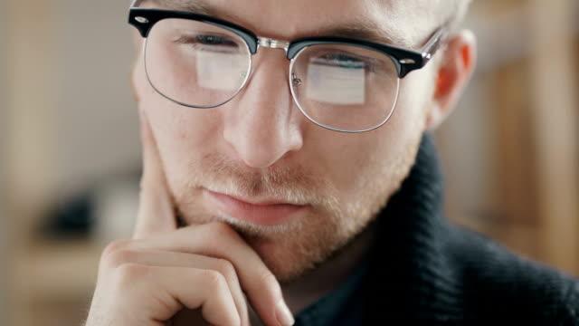 Businessman or estate agent checking a property portfolio online video