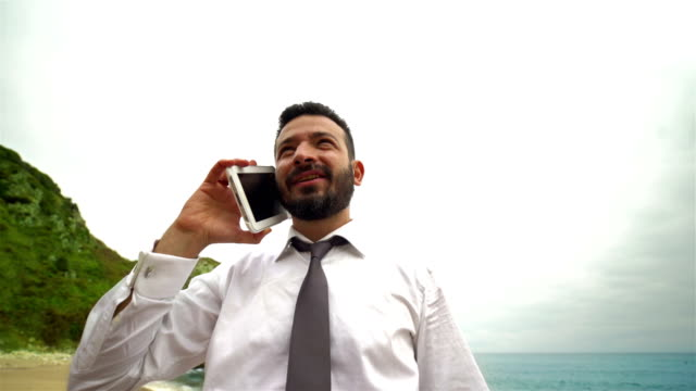 Businessman Phone Talking on the Beach - 4K Resolution video