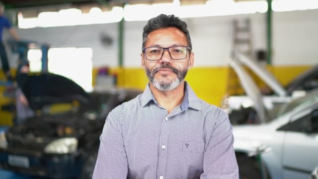 Businessman portrait in auto repair shop