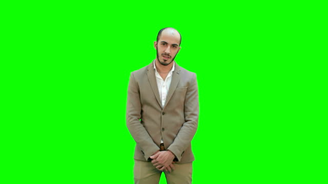 Businessman presenting project looking at camera on a Green Screen, Chroma Key video