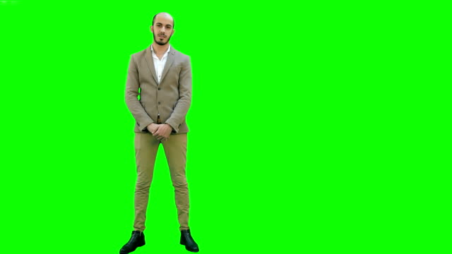 Businessman presenting project to the camera on a Green Screen, Chroma Key video