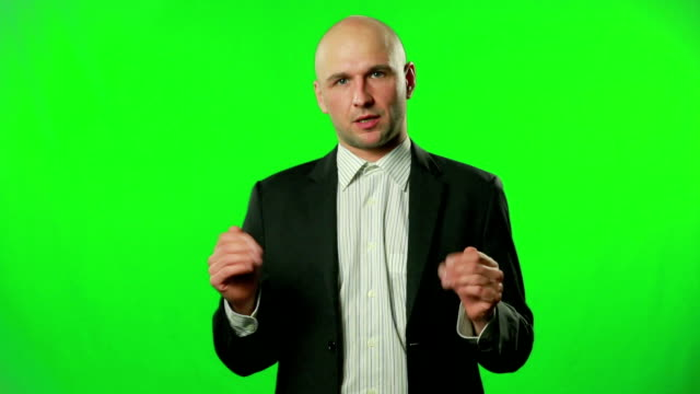 Businessman presenting something in the studio against a green screen video