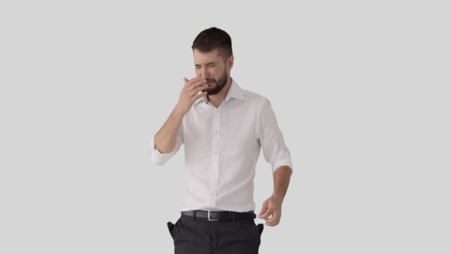 Businessman pulling out his empty trousers pockets and crying video