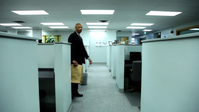 Businessman puts paper bag over head  cube stock videos & royalty-free footage