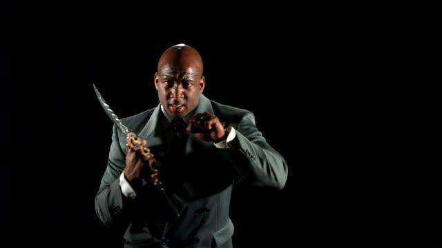Businessman ready to fight with ninja weapon  ninja stock videos & royalty-free footage