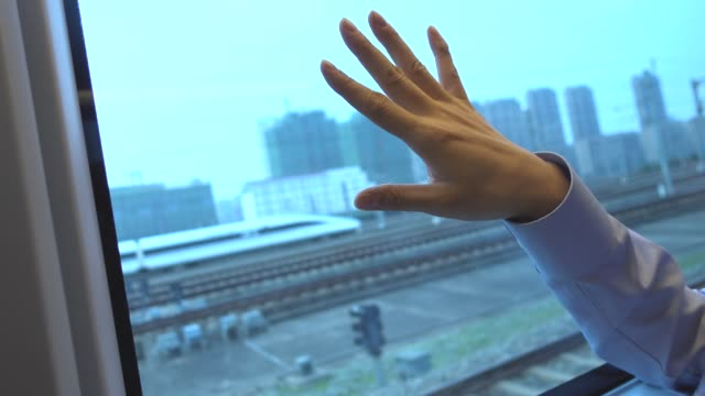 businessman relaxing in high speed train - solo un uomo video stock e b–roll