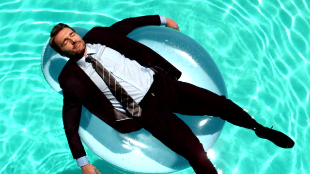 Businessman relaxing on buoy video