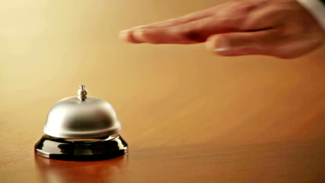 businessman ringing a service bell