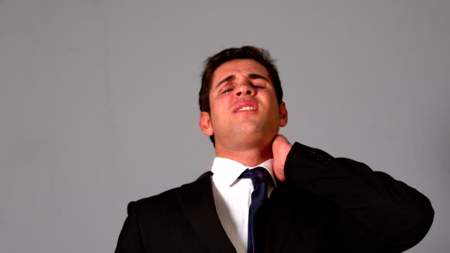 stockvideo's en b-roll-footage met businessman rubbing his sore neck - overhemd en stropdas