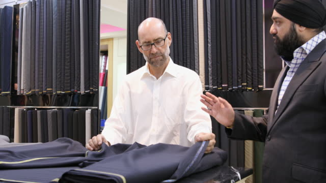 Businessman Selecting Fabric for a Custom Made Suit video