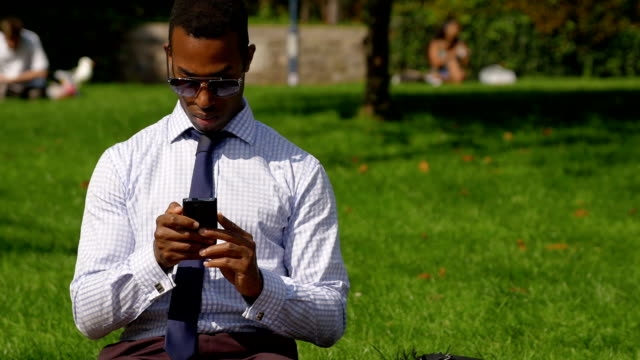 Businessman sending messages or Email with a mobile phone: smartphone video