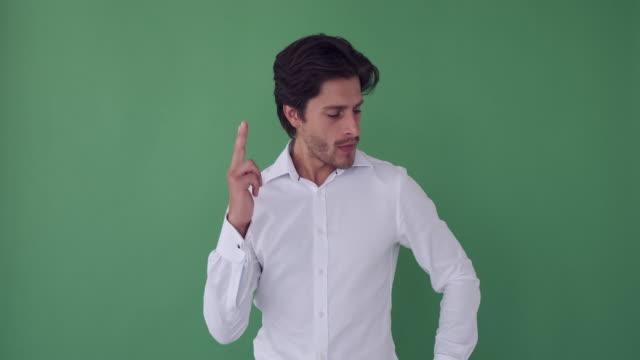 businessman shooting with air gun - mani sui fianchi video stock e b–roll