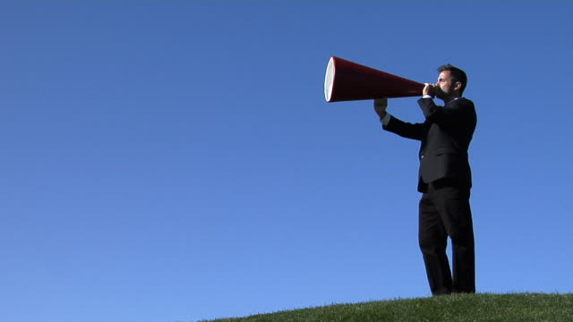 Businessman shouting through a megaphone Businessman shouting through a megaphone megaphone stock videos & royalty-free footage