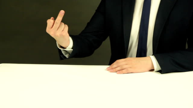 Businessman Showing an Obscene Gesture Businessman in suit showing middle finger middle finger stock videos & royalty-free footage