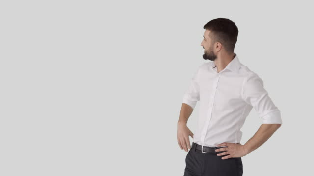 Businessman showing blank copy space on his side Businessman presenting blank copy space on his side for your text or product arms akimbo stock videos & royalty-free footage
