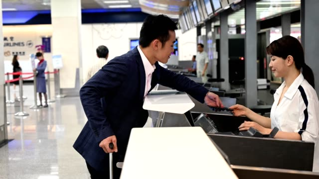Businessman showing electronic ticket at airport