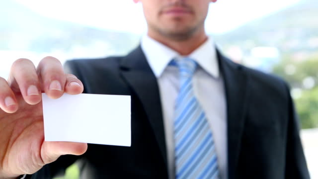 businessman showing his card - business card stock videos & royalty-free footage