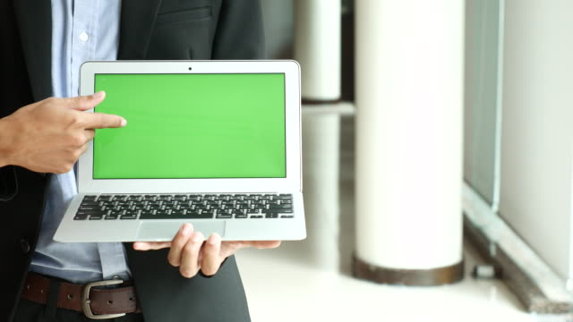 Businessman Showing Laptop with Green screen display,Chroma key video