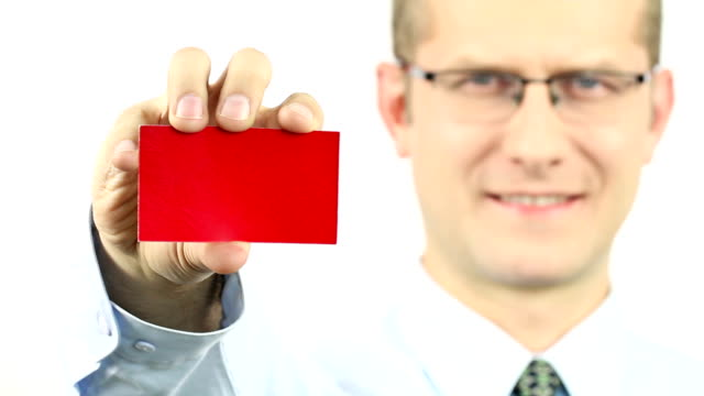 Businessman showing red business card Businessman showing red business card isolated on white business card stock videos & royalty-free footage