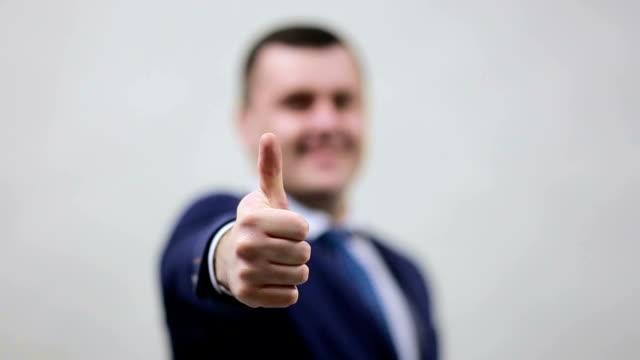 Businessman showing thumbs up - closeup shot video