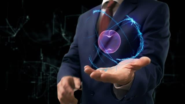 Businessman shows concept hologram 3d apple on his hand