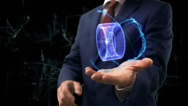 Businessman shows concept hologram 3d cast disc on his hand