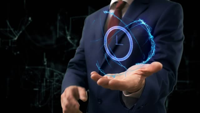 Businessman shows concept hologram 3d clock on his hand Businessman shows concept hologram 3d money on his hand. Man in business suit with future technology screen and modern cosmic background instrument of measurement stock videos & royalty-free footage