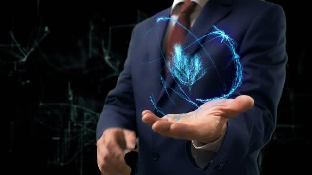 実業家は、彼の手でコンセプト ホログラム 3 d ツリーを示しています - 生態系点の映像素材/bロール