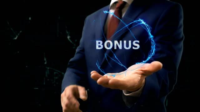 Businessman shows concept hologram Bonus on his hand video