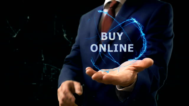 Businessman shows concept hologram Buy Online on his hand video