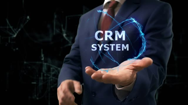 Businessman shows concept hologram CRM system on his hand