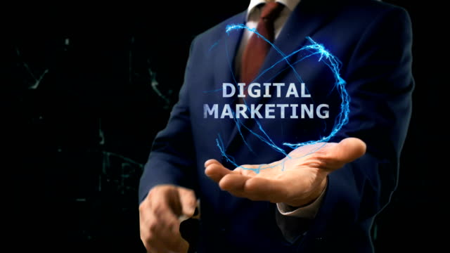Businessman shows concept hologram Digital marketing on his hand Businessman shows concept hologram Digital marketing on his hand. Man in business suit with future technology screen and modern cosmic background digital marketing stock videos & royalty-free footage