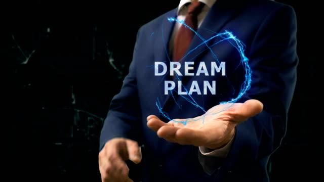 Businessman shows concept hologram Dream plan on his hand video
