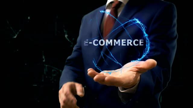 Businessman shows concept hologram E-commerce on his hand video