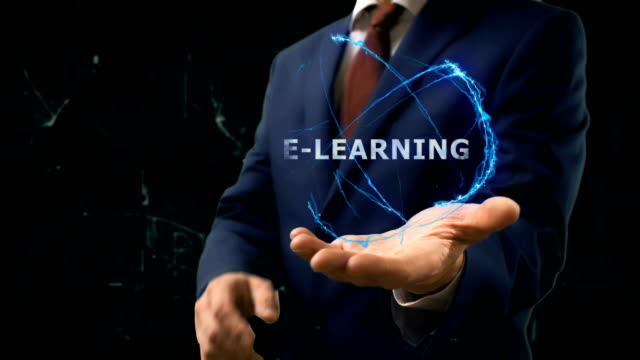stockvideo's en b-roll-footage met zakenman toont concept hologram e-learning op zijn hand - e learning
