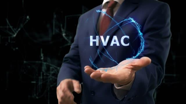 vídeos de stock, filmes e b-roll de empresário mostra holograma conceito hvac na mão - ar condicionado
