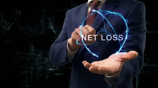 Businessman shows concept hologram Net Loss