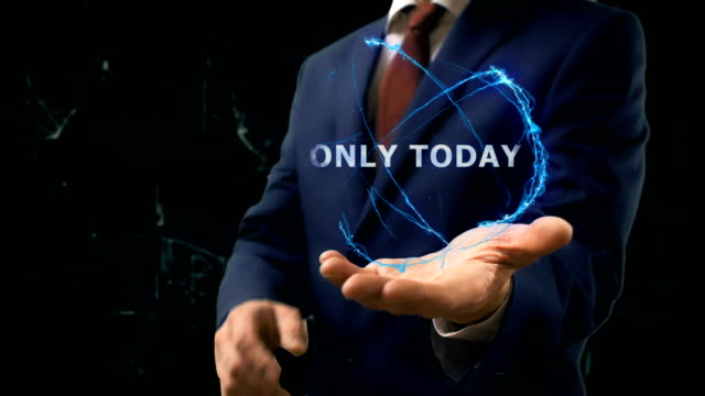 Businessman shows concept hologram Only today on his hand video