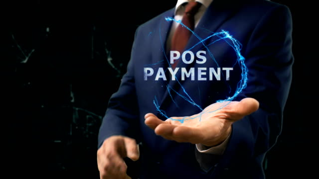 Businessman shows concept hologram POS Payment on his hand video