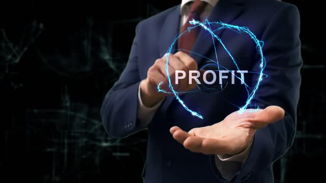 Businessman shows concept hologram Profit