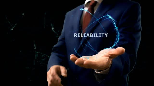 geschäftsmann zeigt konzept hologramm zuverlässigkeit des internets online auf seiner hand - reliability stock-videos und b-roll-filmmaterial