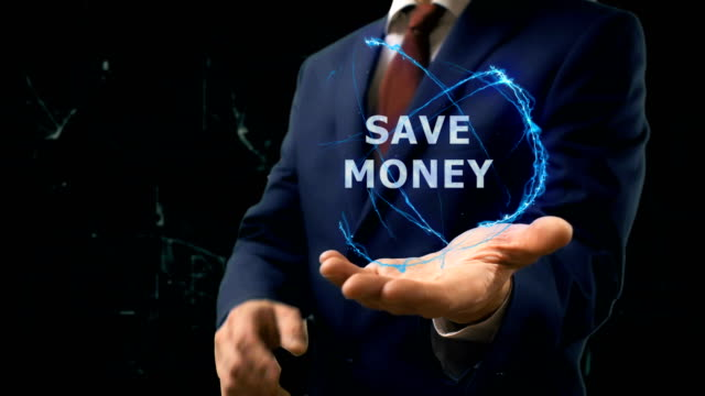 Businessman shows concept hologram Save money on his hand video