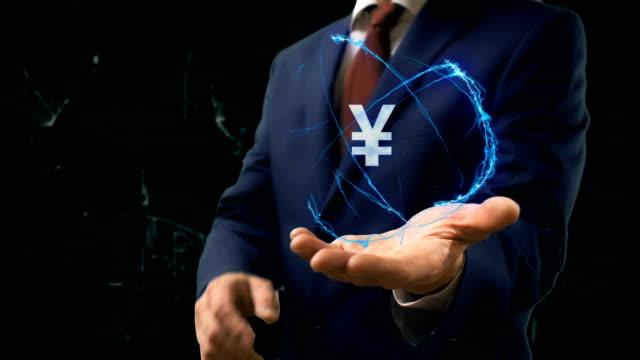 stockvideo's en b-roll-footage met zakenman toont concept hologram teken jpy op zijn hand - yenteken