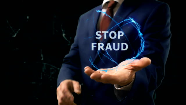 Businessman shows concept hologram Stop fraud on his hand video