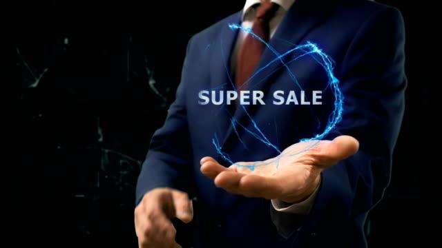 Businessman shows concept hologram Super sale on his hand video