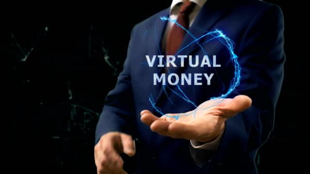 Businessman shows concept hologram Virtual money on his hand video