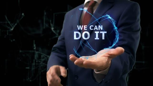vídeos de stock e filmes b-roll de businessman shows concept hologram we can do it on his hand - filosofia