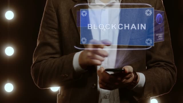 affärsman visar hologram med text blockchain - chain studio bildbanksvideor och videomaterial från bakom kulisserna